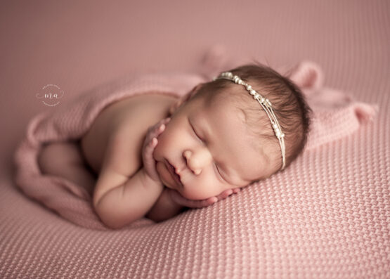 metro detroit michigan newborn maternity photographer side lay pink with pearl headband