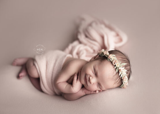 troy michigan newborn photographer melissa anne photography smiling baby girl with floral crown