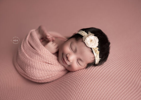 troy michigan newborn photographer melissa anne photography smiling baby girl wrapped in pink